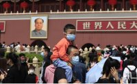 China posts slowest population growth in decades