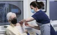 UK scrambles for hospital beds as virus surges