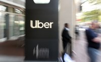 Uber lays off 3,700 as virus upends sharing economy