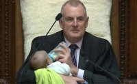 Baby joins New Zealand's Speaker during parliament debate