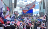 Seoul considers 'no-rally day' at squares