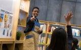 Global intern from Rwanda reads books to children