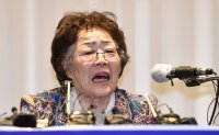 Former 'comfort woman' renews attack on activist-turned-lawmaker-elect