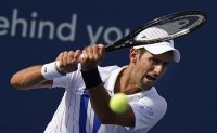 Djokovic's neck better, as is his play; now 20-0 in 2020