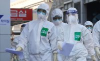 Korea reports 100 new virus cases, total now at 9,137
