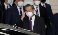China's foreign minister Wang Yi arrives in Seoul