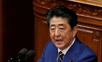 Ex-Japan PM Abe asked by prosecutors to appear for questioning: local media