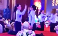 Chinese staff made to slap each other on stage at company's anniversary celebration