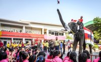 Elephant Santas deliver Christmas presents at Thai school