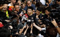 Hong Kong activist Joshua Wong arrested in crackdown on protests