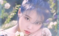 IU's agency kicks out fans for illegally streaming concert