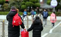 A year into pandemic, new school year starts amid hopes and concerns