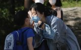 2.4 million students return to school amid new wave of infections