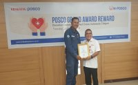 POSCO employee donates reward money to charity