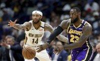 James' triple-double lifts Lakers past Pelicans, 122-114