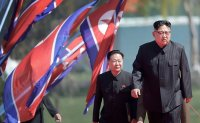 Kim remains unseen, Pyongyang's media focus on army anniversary