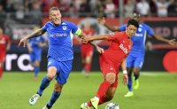 Cup thrills in Korea and England