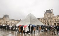 France closes Louvre as virus cases mount in Europe