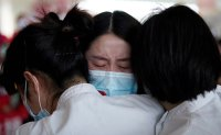 Hugs, tears of joy after end of Wuhan lockdown [PHOTOS]