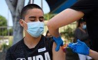 Despite assurances, some don't feel safe taking masks off just yet
