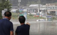 President declares 7 flood-battered parts of Korea as special disaster zones
