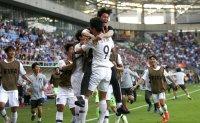 Korea knocks off Japan to reach quarterfinals