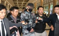 Kazakh man extradited to Korea for injuring child in hit-and-run