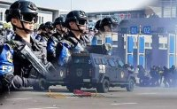 Chinese police prepare for Macau handover anniversary with anti-terror drill near Hong Kong
