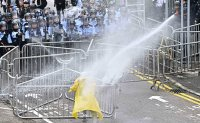 Hong Kong protesters prepare for worst as riot police gather