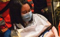 Hong Kong police searching protesters harass hospital staff