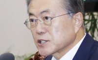 Moon brushes aside 'public division'