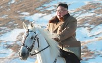 N. Korean leader scales sacred mountain on horseback. Any bold decision in making?