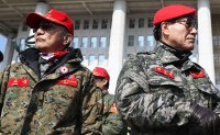 Debate rises over military uniforms at political rallies