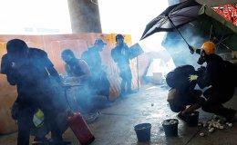 Hong Kong police start firing tear gas on universities