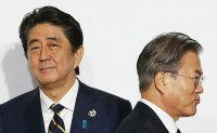 Moon to hold bilateral summit with Abe in China next week