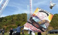 Ruling party chief expresses regret over criticism of new law banning anti-Pyongyang leaflets