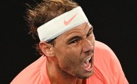 Nadal says back injury much improved as he reaches last 16