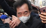 Ruling party chairman egged by woman protesting new theme park project in Chuncheon