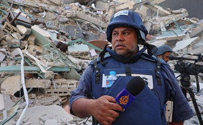 Israel pounds Gaza, flattens building housing AP and Al Jazeera