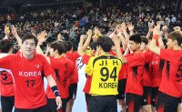 Unified Korean team loses last match at handball worlds