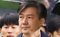 Ex-justice minister attends court hearing over ex-vice mayor's bribery case