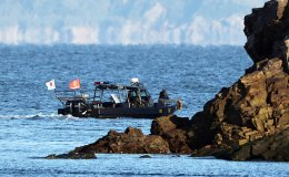 North Korea warns South against violating sea border to search for missing official