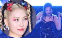 Typhoon soaks K-pop star during campus show