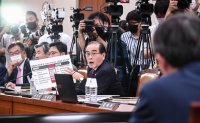 Defector-turned-lawmaker under fire for 'ideological verification' of minister nominee