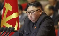 Kim vows to bolster North Korea's military at party meeting