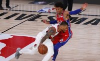 Lillard scores 51 in Portland win as Sixers lose Embiid