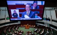Hong Kong faces worst financial crisis in over 20 years, finance chief warns