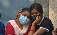 India's COVID-19 deaths climb again as global aid flown in