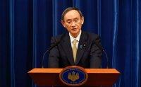 Japan expands virus emergency, tightens border restrictions