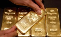 Gold above $1,800 an ounce, first time since 2011